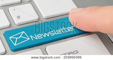 A Keyboard With A Blue Labeled Button - Newsletter