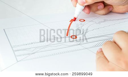Closeup Photo Of Businessman Drawing Increasing Graph On Chart With Financial Stock Data