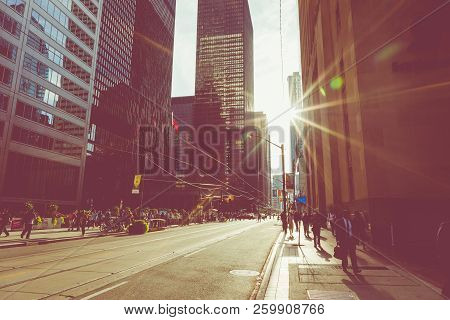 Toronto, Canada - September 17, 2018: Rush Hour At Toronto Downtown, Many People On The Street. Suns