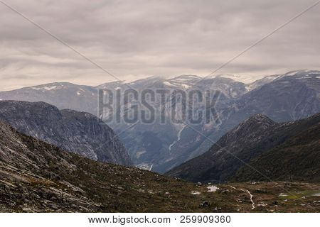 Rugged Dramatic Mountain Landscape In Norway Cloudy Dramatic Day Autumn