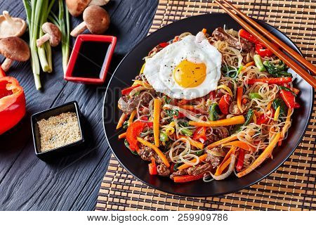 Delicious Korean Dish Japchae: Mix Of Glass Noodles, Beef And Stir Fried Onion, Bell Pepper, Garlic,