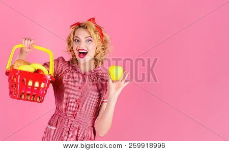 Woman Shopping At Supermarket. Pinup Girl With Shopping Basket&apple. Smile Lady Holds Grocery Baske