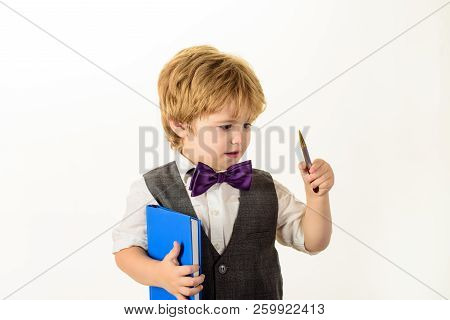 Schoolboy With Book And Pen. Back To School, Elementary Education Concept. Fashion For Kids. Kid Rea