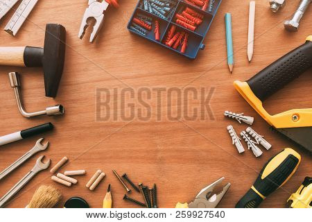 Handyman Maintenance And Repair Project Tools On Workshop Desk, Top View