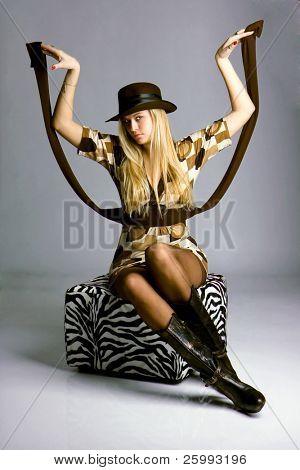 Beautiful fashion woman portrait with brown hat, studio shot
