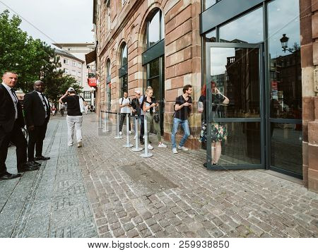 Strasbourg, France - Sep 21, 2018: Apple Store With Customers People Queuing In Front Of Apple Store