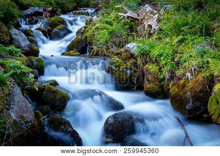 Nice landscape with waterfall on mountain stream