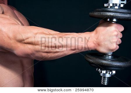 Bicep with hand weight close up , isolated on black background