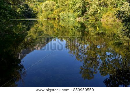 Forest River Reflection Autumn Landscape. Autumn Forest River Water Panorama. Forest River Reflectio