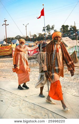 ALLAHABAD, INDIA -11 FEBRUARY: Guru with his disciples on Kumbh Mela the largest religious gathering on earth , February 11, 2008. Allahabad, Uttar Pradesh, India