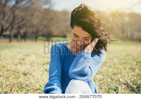 Happy Dreamy Female With Closed Eyes With Hand On Face. Portrait Of Attractive Brunette Caucasian Yo