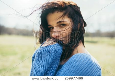 Portrait Of Attractive Brunette Caucasian Young Woman With Windy Hair, Dreaming Outside, On Spring O