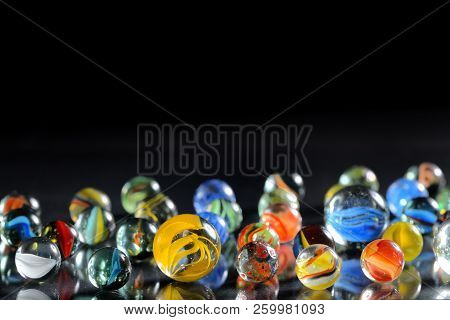 Different Marble Glass Balls On Black Background