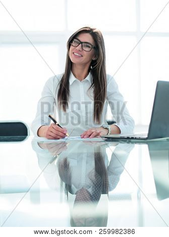 successful business woman sitting at the office Desk