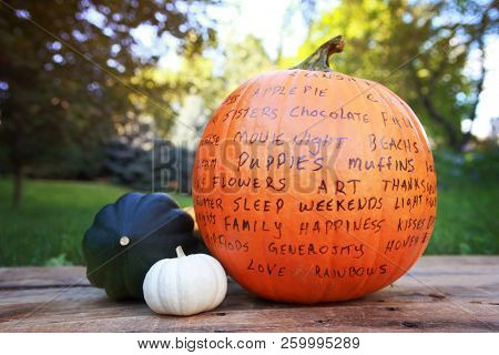 Image of a Thankful Pumpkin holiday craft tradition, thankful words written on a pumpkin