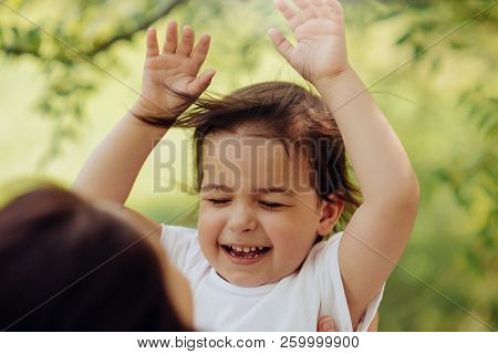 Horizontal Portrait Of Happy Smiling Little Cute Daughter Kid Have Fun Outdoors In The Park. Good Re