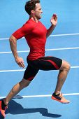 Runner sprinting towards success on run path running athletic track. Goal achievement concept. Male athlete sprinter doing a fast sprint for competition on blue lanes. Track running. poster