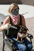 A crazy woman with Hypno Glasses gets ready to inject her Dog with unknown substances poster