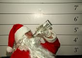 Bad Santa Santa Claus has been a bad bad boy this year and was arrested, and had his mugshot taken  Dark Christmas Humor images for all to enjoy poster