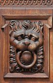 Medieval wooden sculpture of a fabulous monster on the gate of the Old Town Hall in Prague, Czech Republic. poster