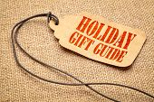 Holiday gift guide sign - a paper price tag with a twine iagainst burlap canvas poster