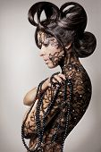 Beautiful fashion model with long black hair. poster