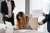 Stressed CEO annoyed by excessive workload and bothering colleag poster