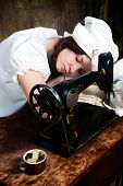 The sleeping young seamstress after wearisome work poster