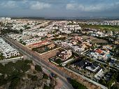 Aerial panoramic photo suburban houses in Miromar residential area of La Mata. Above top view townscape urban scene. Province of Alicante Costa Blanca. South of Spain poster