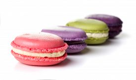 Four Macaron Cookies Isolated On White Background