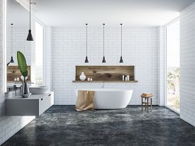 White Brick Bathroom Interior With A Concrete Floor, A White Bathtub, A Round Sink, Several Ceiling