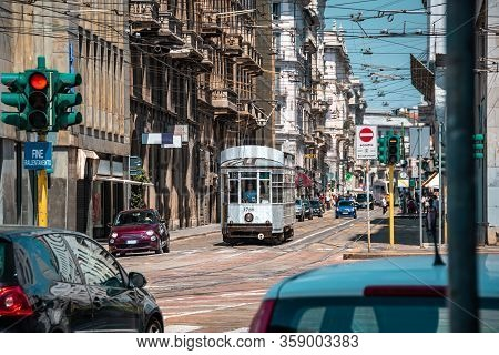 Milan, Italy- 06.07.2019: Milan Street Panorama Old White Tram And Cars. Vintage Tram. European Publ