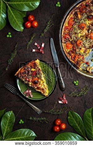 Slice Of A Big Quiche Lorraine With French Cheese