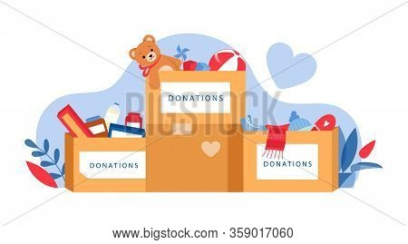 Concept Of Social Care, Clothes And Toys Donations. Boxes With Things And Toys To Donation For Needi