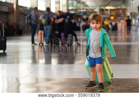 Crowded Airport. Transport Collapse Due To The Virus. Optimistic Traveler Child. Traveling With Chil