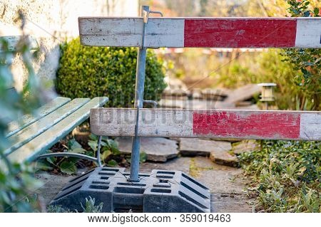 Construction Barrier In Front Yard. Barricade For Construction Site Of Sewerage Shaft. Focus On Fore