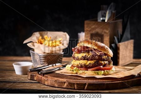 Juicy American Burger, Hamburger Or Cheeseburger With Two Beef Patties, With Sauce And Basked On A B