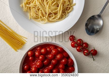 Plate Of Pasta Or Spaghetti And A Bowl Of Tomato Sauce Overhead View Surrounded By Fresh Tomatoes, R