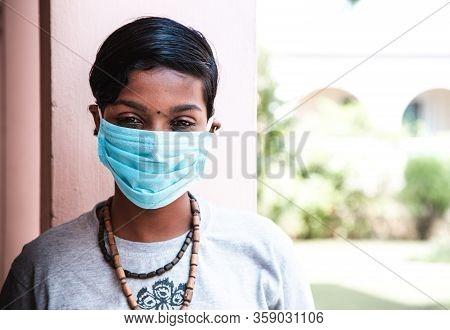 Coronavirus. Portrait Of Beautiful Sad Young Dark-skinned Teenage Girl In Protective Face Mask. Coro