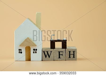 Wooden Home With Miniature Office Table On Wooden Blocks Word Of Wfh : Work From Home. Comfortable P