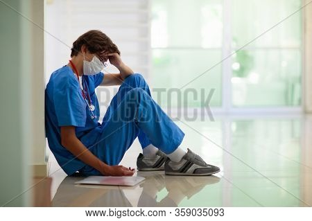 Exhausted Tired Doctor Or Nurse. Virus Outbreak. Coronavirus Pandemic.