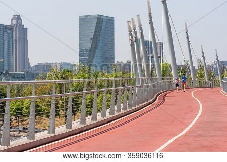 Chengdu, Sichuan Province, China - March 31, 2020 : People Running On Chengdu South Greenway With Sk