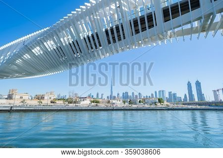 Twisted Bridge. Structure Of Architecture With Lake Or River, Dubai Downtown Skyline, United Arab Em