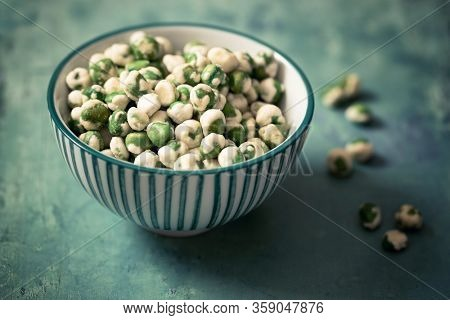 A bowl of wasabi peas, a spicy Japanese savory snack of dried green peas with a wasabi horseradish coating.