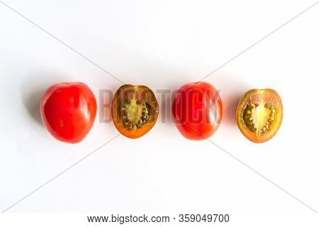 Ripe Red And Green Cherry Tomatoes In A Row. Whole And Halves Of Vegatbles On White Background