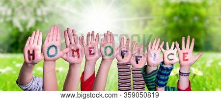 Kids Hands Holding Word Homeoffice Means Work From Home, Grass Meadow