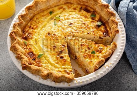 Quiche Lorraine With A Slice Cut For Breakfast