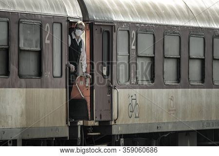 Ruzomberok, Slovakia - April 1, 2020: Steward With Face Looking From Dirty Train