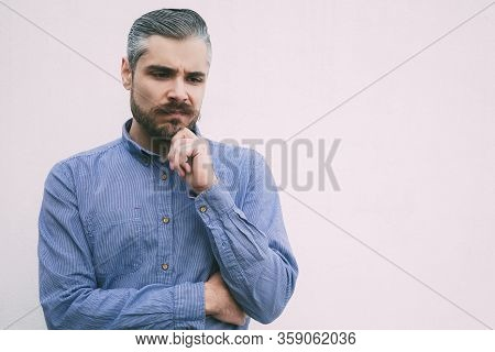 Pensive Focused Man Thinking Over Problem Solving. Grey Haired Young Man In Blue Casual Shirt Posing