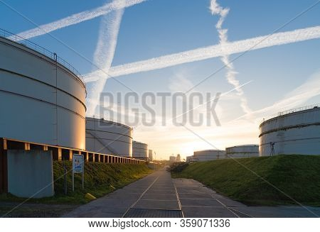 Several Large Storage Tanks For Petrol In The Rotterdam Port At Sunrise